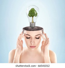 Open minded woman with green energy symbol