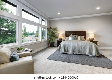 Open modern bedroom interior with large windows and grey walls
