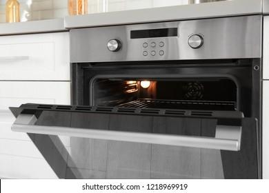 Open modern oven built in kitchen furniture, closeup