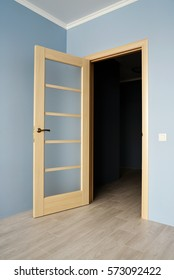Open Modern wooden Door with glass on Blue Wall