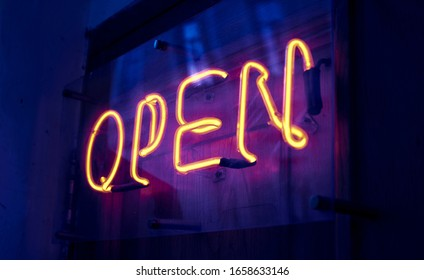 Open. Neon sign on the door. invitation to a night club.