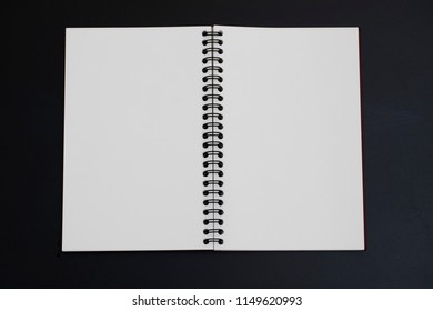 Open new blank book isolated on black for write everything on it.