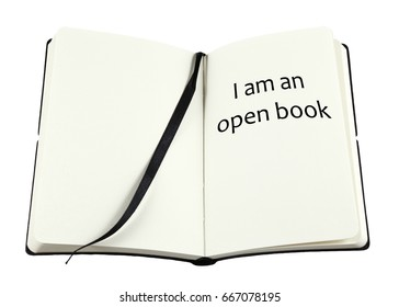 An open note book with the phrase: I am an open book, isolated against white.