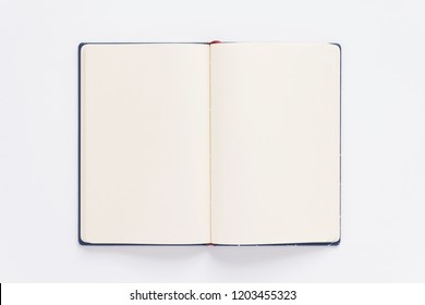 open notebook or book with empty pages on white  background, top view