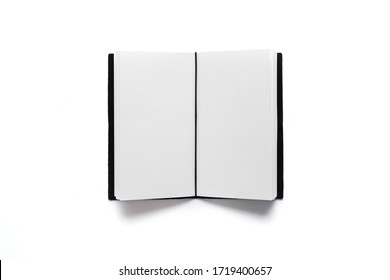 Open notebook with clear pages on white background