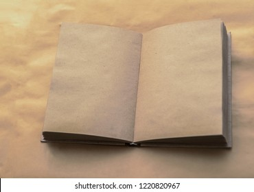 Open notebook with empty craft texture pages. Personal diary with empty pages on a brown or yellow background. A book with empty page. Top view. empty Copy space for inscription. back to school