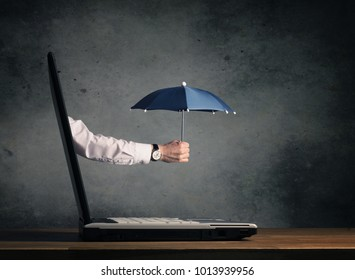Open notebook with hand holding an umbrella, protection or security concept image