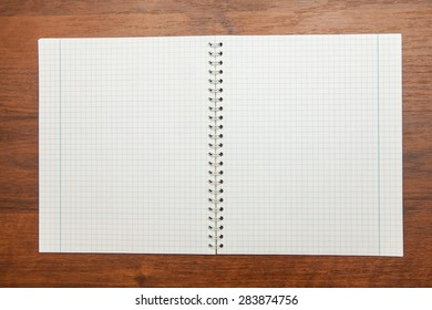 open notebook on a wooden background