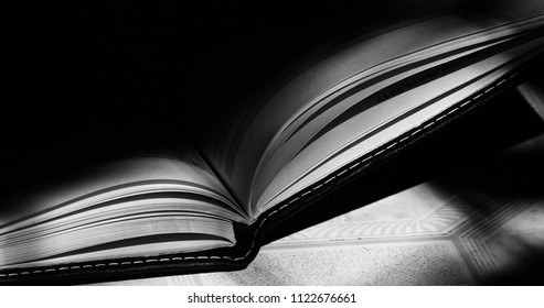 An open notebook with pages isolated unique black and white photograph