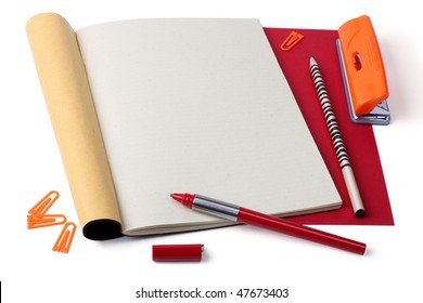 Open notebook with pen, pencil, paper clips and hole punch. - Shutterstock ID 47673403