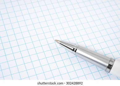 Open notebook and pen for writing .