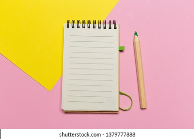 open notebook with pencil on a gray background. Office notepad flat lay. Top view with copy space