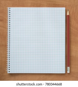 open notebook and red pencil