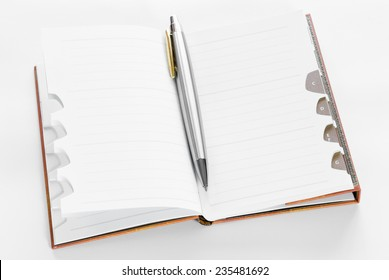 Open notepad with ballpoint on white background with plenty of copyspace