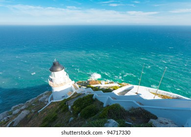 Open ocean and the Dongyong lighthouse seen from above atop the steep hill behind on Dongyin island on the Matsu archipelago in Taiwan.  Horizontal copy space