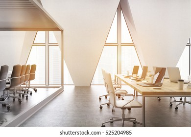 Open office with rost of tables with computers and three triangular windows. 3d rendering. Toned image