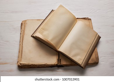 Open old book with blank pages