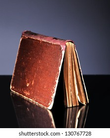 Open old book and cover, vintage objects and reflection
