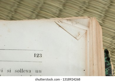 Open Old book details with signs of use and age.
