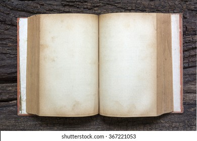 Open old book on wood