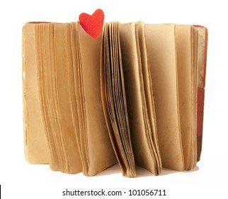 Open old book and  red heart