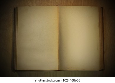 open old book without text on a wooden background. from above