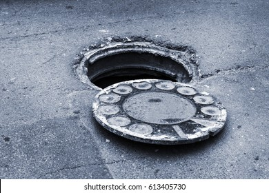 open old manhole and repair of roads