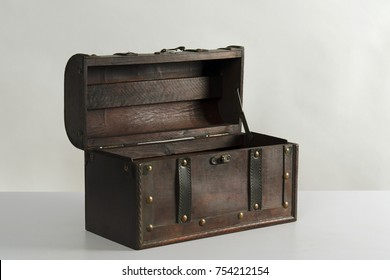 Open old traveling case of leather and wood to fill with treasures in studio against white background.