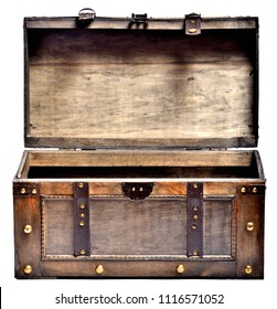 Open old wooden chest with ornamental forging and leather straps isolated on white background