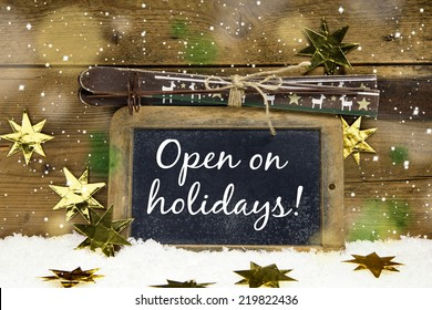 Open on Christmas: sign with text for winter skiing holidays and tourists.