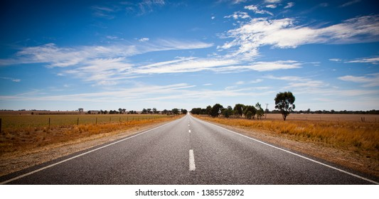 Open outback road in Victoria, Australia. Straight single lane road stretching into the distance.