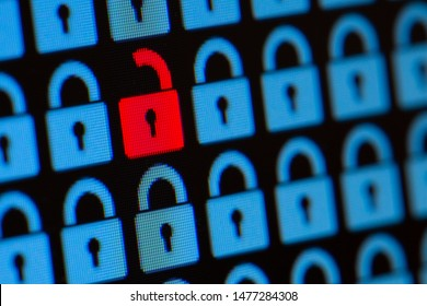 Open padlock as a symbol of the loss of personal information. Hacking or open data. Blue and red pixel locks on a black background, close up.