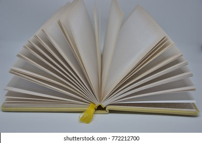 Open pages of notebook with a yellow tab on white background