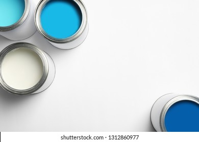 Open paint cans on white background, top view. Space for text