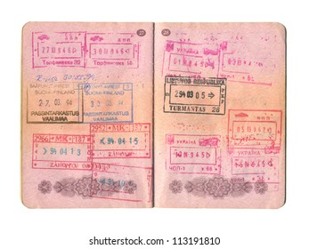 The open passport with the stamps close up.