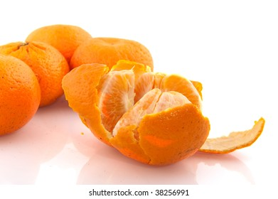 open peeled citrus tangerine isolated over white