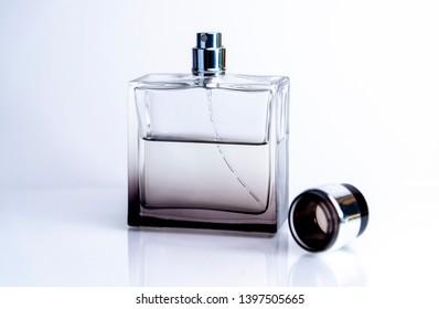 Open perfume bottle capon white background