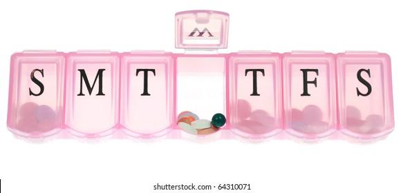 Open pill box.