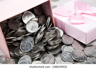 open pink gift box with russian ruble coins close up