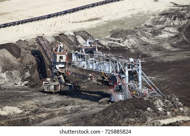Open pit coal mine with excavator heavy machinery