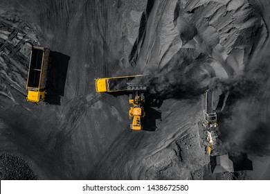 Open pit mine, coal loading in trucks, transportation and logistics, top view aerial drone.