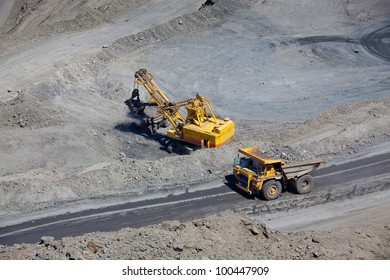 Open pit mine with supersize car and excavator