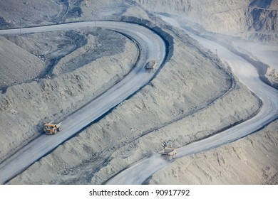 Open pit mine with supersize car