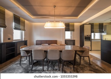 Open plan apartment interior, kitchen and dining area
