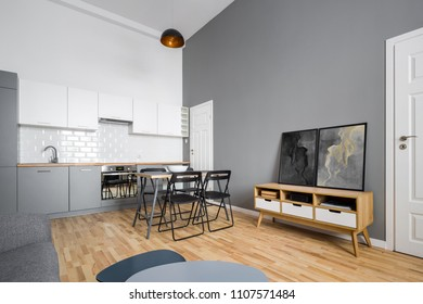 Open plan kitchen with simple table and chairs