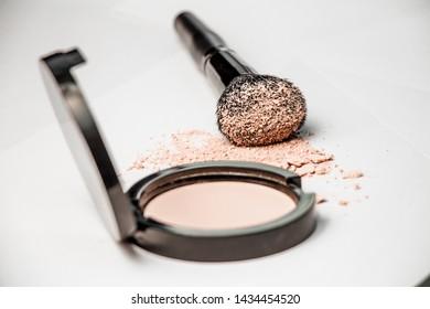 open powder box, black make-up brush, powder hill