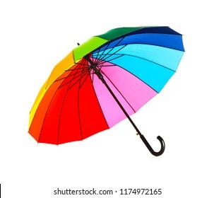 Open rainbow color umbrella on white background