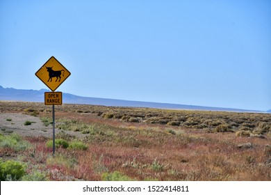 Open range sign in Nevada with a few bullet holes in it.