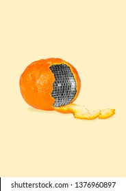 Open the real adventures. A mandarine as a retro discoball inside on yellow background. Negative space to insert your text. Modern design. Contemporary art collage. Concept of food, dance, weekend.