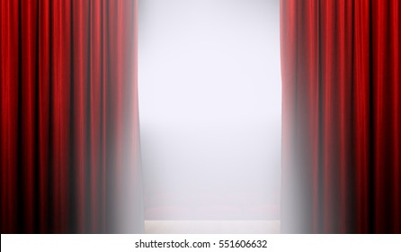 Open red curtain on stage with bright spotlight